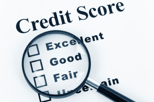 Checking Credit Score With Magnify Glass