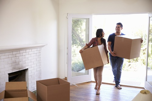A young couple moving into their new home