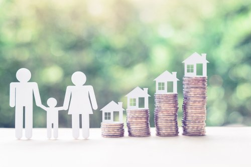 images of paper cutout of people and homes along with stacks of coins