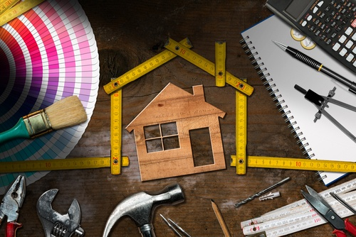 Measuring a wood house with architect tools