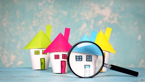 picture of 3 houses with magnifying glass