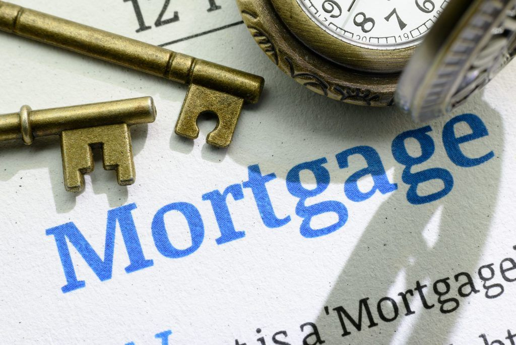 image of the word mortgage along with some keys and a watch