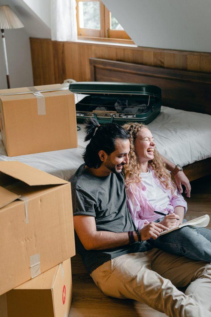 Couple looking at homes to buy and rent